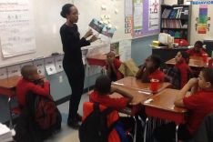 A teacher reading Penny and the magic puffballs to her class